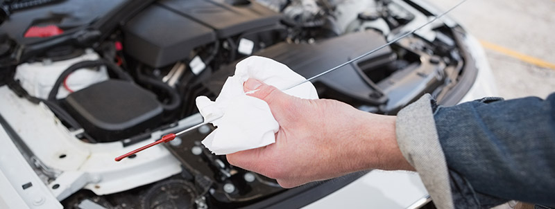 Mechanic cleaning the dipstick - Car Servicing Bathgate